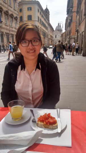 Angie eats lasagna in Rome